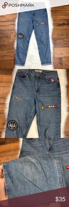 """Topshop Moto Mom Jeans Embroidered Patches Topshop Moto Mom Jeans Embroidered Patches Light Wash. Patches aresturdy. Jeans are pre-rolled at the bottom. Slight wear on knees shown in photos. Size 28. The waist measures 14"""" across. The rise is about 11"""". The inseam is about 26.5"""". Topshop Jeans"""