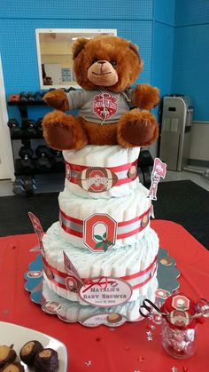 Diaper Cakes - OSU theme for my friend's baby shower. Major hit. Each had 61 Diapers and Ohio State University Cut-outs and Bear. Love these.