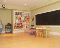 Basement Playroom Design with large chalk board by the bunkbeds opposite side from movie theatre