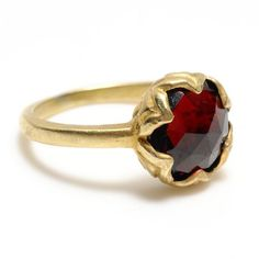 This amazing rose cut ring has lots of sparkle and shine. the hand carved petal setting slightly folds over the stone.    Metal: 18k yellow gold vermeil  Stones: Garnet  $218.00