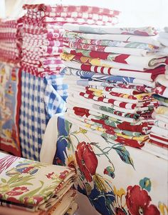 happiness is a pile of vintage tablecloths