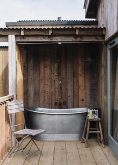 Just outside one of the guest cabins at Soho House's buzz-worthy new English private member's club and country house hotel, Soho Farmhouse, a galvanized steel soaking tub has simple,. Outdoor Bathtub, Outdoor Bathrooms, Outdoor Showers, White Bathrooms, Luxury Bathrooms, Master Bathrooms, Dream Bathrooms, Farmhouse Bathrooms, Contemporary Bathrooms