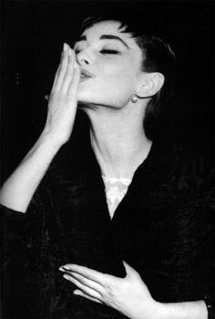 Audrey Hepburn blows a kiss.
