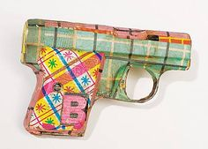 Papermache #gun.  Hmmmm - I think I'm going to make some.  Maybe mosaic a couple.