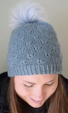 Free Knitting Pattern for Clover Hat - This beanie with pom pom features an interesting stitch pattern that uses a technique of lifting lower stitches to create the little leaves. In baby and adult sizes. Designed by Susan B. Anderson