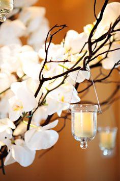 Branches and hanging votive wedding centerpiece.