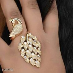 Rings Women's Alloy Gold Plated Rings Material: Alloy  Size: Free Size ( Adjustable) Description: It Has 1 Piece Of Women's Finger Ring Work: Stone Work Country of Origin: India Sizes Available: Free Size   Catalog Rating: ★4 (477)  Catalog Name: Women's Alloy Gold Plated Rings CatalogID_337991 C77-SC1096 Code: 602-2512739-924