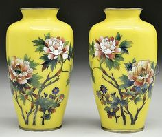 "Early 20th century, Japan. Flowers on a yellow ground. SIZE: Each is 7"" h. PROVENANCE: From a private New York State collection."