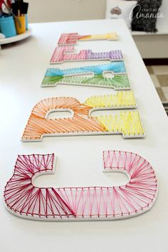 Colorful String Art Wall Letters. Fun idea for a kids room too! Decorative Wall Letters, String Letters, Wall Letters Decor, Decorating Letters, Craft Room Signs, Playroom Signs, Craft Letters, Large Letters, Craft Rooms
