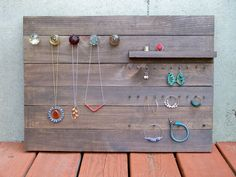 ::Reclaimed by RusticWoodOriginals::  http://www.etsy.com/listing/98759441/reclaimed-wood-jewelry-organizer-large