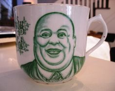 "I've had this one for decades and it is GIGANTIC!   Porcelain Mug- sold for  25.00 This unique  mug has the cutest saying, ""I am not greedy but I like a lot."" And next to that is a chubby jovial bald man. Art work is green and very highly detailed. Gold rim is missing.There is a embossing around the bottom of the mug.    The mark is Leuchtenburg Germany. Dating 1895-1937."