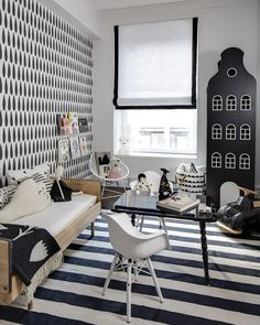 """Name: Adrienne Designer: Sissy + Marley Location: New York City Welcome to Adrienne's stylish digs. This young lady inhabits what is rightly described as """"black, white and chic all over"""" by the design team Sissy+Marley. Fresh off the launch of their new line of wallpaper, the designers used their DROPS paper as the starting point for the room's bold monochromatic palette."""