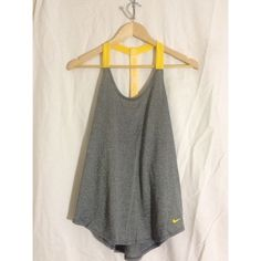 NWOT Nike Workout Tank Top ACCEPTING OFFERS!!. No trades. No low ballers. New without tag. Just do it logo on band. Yellow and gray. Cute tank top for working out. Pair with nike sneakers and leggings for a complete outfit. Nike Tops Tank Tops