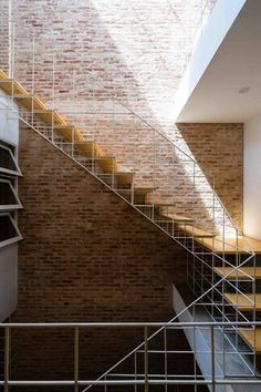 Block Architects adds trellises and steel-bar walls to Vietnamese house Staircase Handrail, Modern Staircase, Stair Railing, Staircase Design, Railings, A As Architecture, Escalier Design, Stair Detail, Stair Nosing