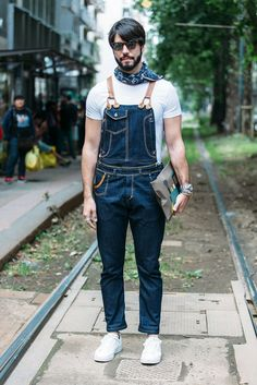 We spot a young man wearing denim dungarees on the streets of Milan in 2016 for #MFW.