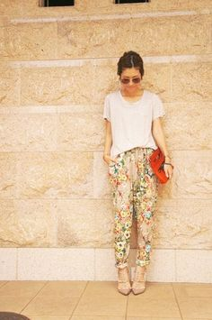 red clutch, floral pants