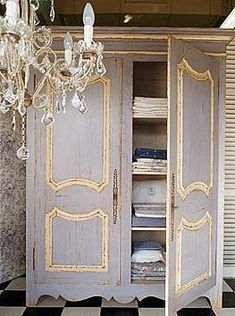 distressed gray armoire with parchment trim