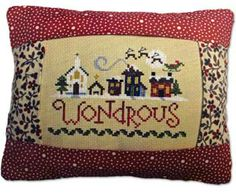 "Wondrous shows #Santa #Claus cruising over the top of the village.  This complete kit contains fabric, thread, needle, instructions and finished 9"" x 7"" tuck #pillows.  Stitch your design and insert it into the opening for a quick finish. The stitch count is 78 x 54.  Fabrics made vary.  #needlework #cross-stitch #xstitch #stitching #embroidery"