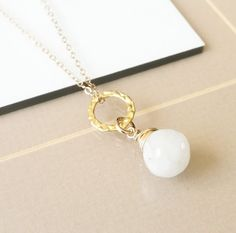 Pretty Moonstone Briolette Necklaces available in gold & silver. Be sure to pop…