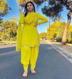 Image may contain: 1 person, standing and outdoor Yellow Punjabi Suit, Punjabi Suit Simple, Salwar Suits Simple, Yellow Suit, Salwar Suit Neck Designs, Neck Designs For Suits, Salwar Designs, Designer Punjabi Suits, Indian Designer Wear