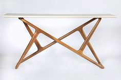 Take home a sleek, modern console with interesting angles and a slim profile. Lark Console Table by Brian Fireman: Wood Console Table available at www.artfulhome.com
