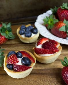 Soft sugar cookie cups get stuffed with cheesecake, then layered with fruit. Yum! A tasty dessert.