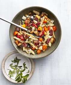Roasted Eggplant and Olive Pasta Salad | This dinner will satisfy all of your savory cravings but it's still pretty healthy. There are briny kalamata olives, tender meaty eggplant, salty feta cheese, fresh tomatoes, and just enough pasta to fill you up. Make sure you roast the eggplant until it's completely tender, otherwise it'll have a spongy texture. The olives get roasted with the eggplant to concentrate their flavor. It's easy to make this entire dish ahead of time; in fact, we…