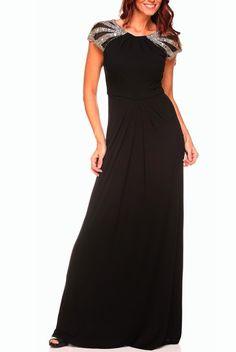 Take your event by storm when they get a glimpse of you in this delicately stunning dress. This gown features a keyhole design with a hook closure, a back zipper closure, short sleeves, mesh detailing adorned with intricate beading and an empire waist with pleated accents. Color: Black Fabric: 28% rayon 28% polyester