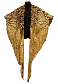 The Golden Cape from the 1963 film Cleopatra. Worn by Liz Taylor, the leather & gold garment is designed to look like the wings of a Phoenix.