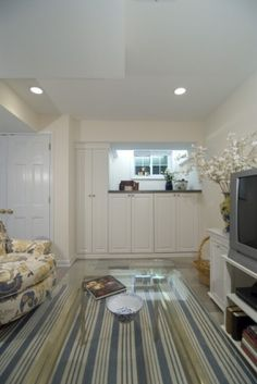 Bright basement space with a mix of patterns and colors, and lots of hidden storage.