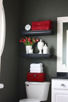 Small bathroom idea...love the colors! Perfect idea for the man cave bathroom, but I think making a wall a chalkboard wall may be appropriate. I don't like the idea if a black bathroom though, may feel too small. But maybe it can be done with the right colors???