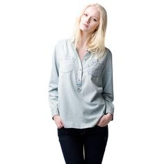 Stylish denim shirt made of fine, pale blue light-weight denim. A trendy mixture of a classical shirt and a Henley include design details like a small stand up collar, elongated pointed button placket and barrel cuffs. Eye-catching destructed details give this shirt its edgy appearance. Two chest pockets. 100% cotton.This shirt runs true to size