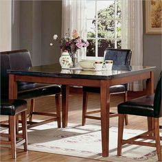https://i.pinimg.com/236x/30/1e/68/301e68525653f6f80178b90bac3d9a63--square-dining-tables-counter-height-dining-table.jpg