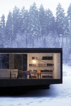 Glass wall in the snow, what a beautiful sight...imagine being on the inside! // architectural inspiration