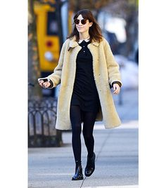 @Who What Wear - Alexa Chung                  Chung added some whimsy to her all-black peter-pan collared Lacoste dress and Darryl KChelsea Boots($324) with this fuzzy camel teddy coat from Marni (similarhere). With a layer this hefty, you can get away with a dress and tights on a sunny day.