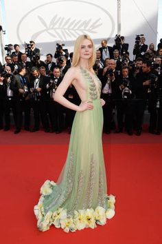 Actress Elle Fanning in Gucci departs after the 'How To Talk To Girls At Parties' screening during the 70th annual Cannes Film Festival at Palais des...