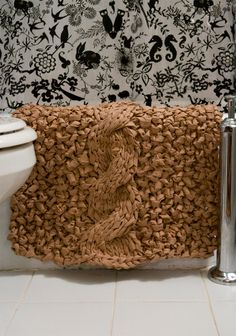 Very cool idea!  Knit rag rug. Make it out of an old sheet (Maybe find something flannel at the thrift store), and knit up w/ giant needles (could make needles out of dowels?)...got some material from thrift store now to get the BIG needles // this would be perfect for my bathroom! Maybe use a few different colors for a unique look.