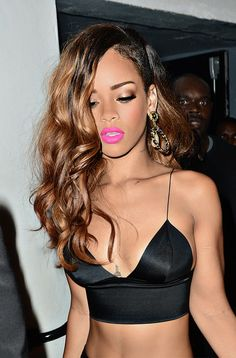 Rihanna with pink lips and tousled hair