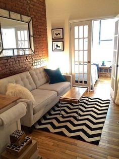 Like the brick, the mirror and the rug.  The table is neat.  We wouldn't want a light colored couch.