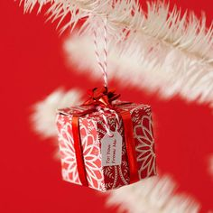 Mini Gift Ornament - who says gifts are just for under the tree - adorable and easy DIY ornaments. More ornament ideas: http://www.bhg.com/christmas/ornaments/easy-christmas-ornaments/