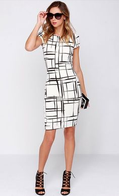 Long and Drawn Out Black and Ivory Print Midi Dres