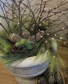 Attractive PIne cones and branches in a white bowl or flower pot
