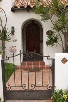 beautiful entry ways ... like this Spanish style house