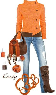 This. Orange. The offset buttons on the sweater. The tall boots.