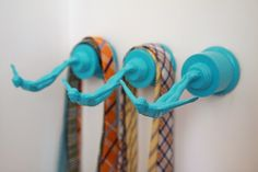 Turn old swim trophies into decorative hooks