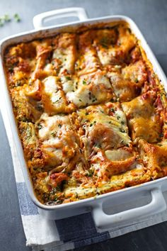 Skinny Spinach Lasagna - thick layers of sauce, noodles, ricotta, spinach, and Mozzarella!