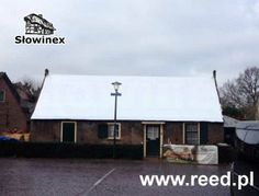 Replacement of a thatched roof on a historic building.  The photo shows an insulation made of aluminum.