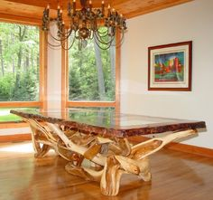 Live Edge Dining Table with Redwood Top and Juniper Base by Woodland Creek Furniture in Custom Made Sizes.