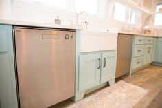 A country farm blue kitchen with cream island. Lenova Stainless Steel Sink Faucet with Side Sprayer SK300. Cutting board countertop island. Stainless Asko Dishwashers Model D5434XLS. No upper cabinets. Cabinets by Hackert & Son in Westmoreland, TN. Elkay Explore™ 29-1/2 in. Single-Bowl Undermount Fine Fireclay Farm Apron Sink. Cabinet color: Farrow & Ball Blue Ground No. 210.