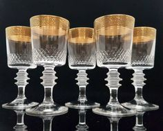 """Rare Mid Century crystal liquor or cordial glasses with a gold rim manufactured by THERESIENTHAL in W. Germany.  Decor: Mintonborte (hard-gold-plated). This is a classical series from 1950s. Typically for this period, it combines elegance with function. Each glass is decorated with rich textured gold rim, the """"Mintonborte"""".  In very good vintage condition - no damages. Please see the pictures for more details.  Each glass is 120 mm (4.72) high. Diameter at the top 55 mm (2.17).  Total weight…"""